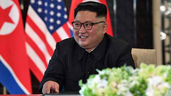 North Korea's leader Kim Jong Un at a signing ceremony with US President Donald Trump (not pictured) during their historic US-North Korea summit in Singapore on Jun 12, 2018. (SAUL LOEB/AFP)