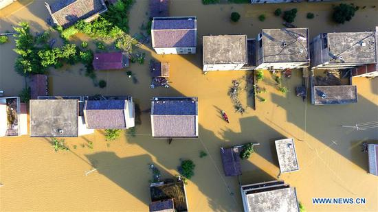 Aerial photo taken on July 8, 2018 shows the flooded area in Qiaoxi Village of Maxu Township of Fuzhou City, east China's Jiangxi Province. Flood caused by heavy rain damaged crops and housings in Maxu Township and rescue groups were set up to help the affected people. (Xinhua/He Jianghua)