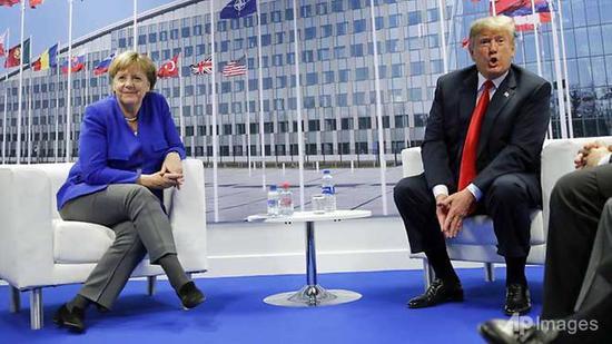 President Donald Trump and German Chancellor Angela Merkel (left) during their bilateral meeting in Brussels, Belgium. (AP Photo/Pablo Martinez Monsivais)