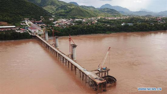 Photo taken on July 11 shows the Luang Prabang railway bridge under construction by the Chinese engineering company China Railway No.8 Engineering Group (CREC-8) on the Mekong River in Luang Prabang, Laos. The concrete casting for the last pier understructure of Luang Prabang railway bridge has been successfully completed, laying down all the foundation construction work of the two cross-Mekong River super major bridges along the China-Laos railway. (Xinhua/Liu Ailun)