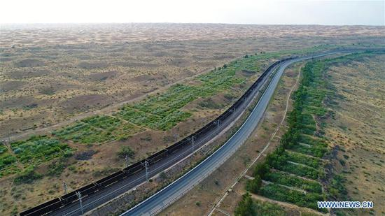 Aerial photo taken on June 26, 2018 shows the Baotou-Lanzhou railway in Zhongwei City, northwest China's Ningxia Hui Autonomous Region. Located at the southern border of the Tengger Desert, Zhongwei City was noted for using straw