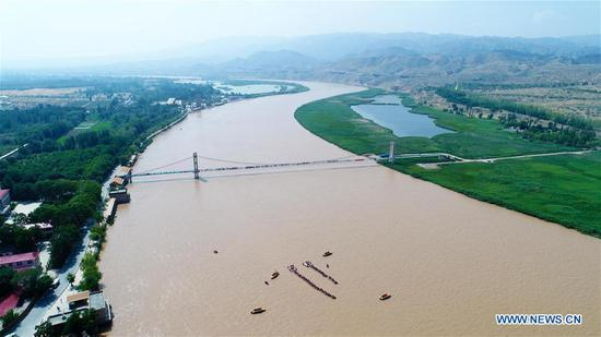 Aerial photo taken on June 27, 2018 shows the Yellow River in Zhongwei City, northwest China's Ningxia Hui Autonomous Region. Located at the southern border of the Tengger Desert, Zhongwei City was noted for using straw
