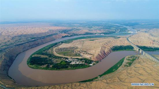 Aerial photo taken on June 26, 2018 shows the Yellow River in Zhongwei City, northwest China's Ningxia Hui Autonomous Region. Located at the southern border of the Tengger Desert, Zhongwei City was noted for using straw