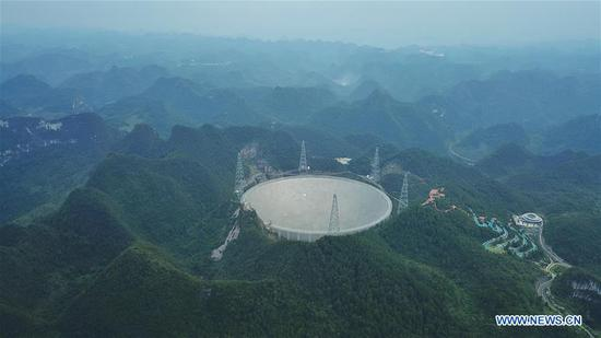 Photo taken on Sept. 10, 2018 shows China's Five-hundred-meter Aperture Spherical Radio Telescope (FAST) in southwest China's Guizhou Province. FAST has discovered 44 new pulsars so far. (Xinhua/Ou Dongqu)