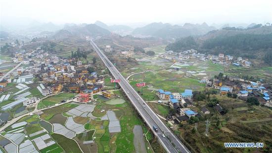 Aerial photo taken on March 5, 2019 shows the spring scenery of Machang Village in Xiasi Town of Kaili, southwest China's Guizhou Province. (Xinhua/Wu Jibin)