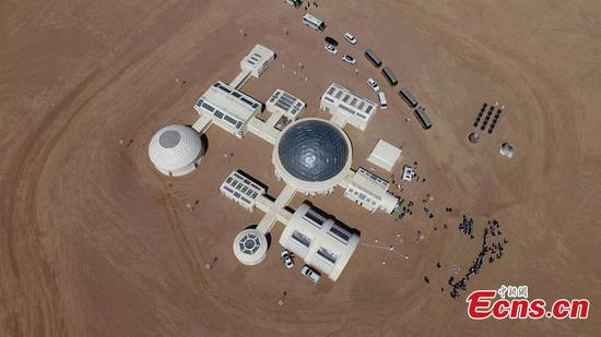 A picture taken with a drone shows an aerial view of the C-Space Project, a Mars simulation base in the Gobi Desert in Jinchang, Gansu Province, China, 16 April 2019. The C-Space Project Mars Base opened officially on 17 April 2019 with the aim to educate and provide an environment for youths and tourists to experience life on planet Mars. The base occupying an area of 11,996 square feet is situated about 40 kilometers from the town of Jinchang in the Gobi Desert. The location is chosen to simulate the landscape and harsh conditions of living on Mars as much as possible. (Photo/China News Service)