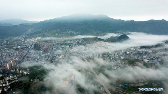 Aerial photo taken on April 25, 2019 shows the scenery of advection fog in Danzhai County, southwest China's Guizhou Province. (Xinhua/Yang Wenbin)