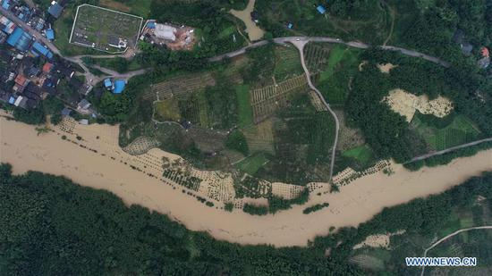 Aerial photo taken on June 9, 2019 shows flood-hit Dajiang Township of Rongan County, Liuzhou City, south China's Guangxi Zhuang Autonomous Region. Guangxi's meteorological bureau on Sunday evening upgraded the meteorological disaster emergency response to level-II after rainstorms starting Tuesday caused flooding in several cities. (Xinhua/Tan Kaixing)
