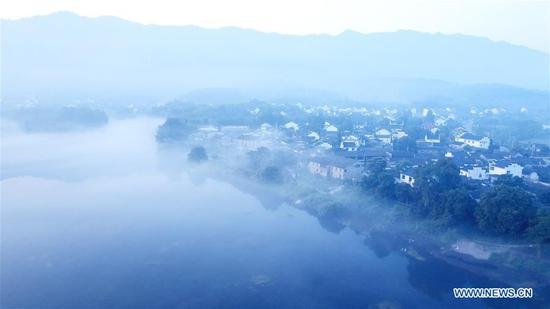 Aerial photo taken on Aug. 15, 2019 shows the scenery of Taohuatan scenic area in Jingxian County of Xuancheng, east China's Anhui Province. (Xinhua/Zhang Duan)