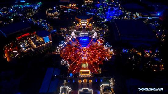 Photo taken on Sept. 13, 2019 shows the night scenery during the Mid-Autumn Festival in Fantawild Theme Park of Cixian County in Handan City, north China's Hebei Province. (Xinhua/Wang Xiao)