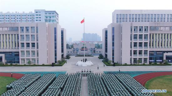 Photo taken on Oct. 1, 2019 shows a flag-raising ceremony at the Army Academy of Artillery and Air Defence of the Chinese People's Liberation Army (PLA) in Hefei, capital of east China's Anhui Province. Celebrations for the 70th anniversary of the founding of the People's Republic of China (PRC) will be held Tuesday in central Beijing. (Photo by Yang Yining/Xinhua)