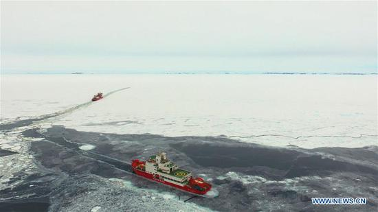Aerial photo taken on Nov. 20, 2019 shows China's polar icebreaker Xuelong (in the distance) following a waterway created by Xuelong 2, another icebreaker, near the coast of Antarctica. China's polar icebreakers Xuelong and Xuelong 2 on Wednesday reached the waters near the Zhongshan Station in Antarctica. (Xinhua/Liu Shiping)