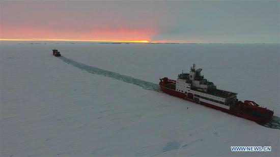 Aerial photo taken on Nov. 21, 2019 shows China's polar icebreaker Xuelong 2 (R) and another icebreaker, Xuelong, sailing at the new broken-through path in Antarctica. China's polar icebreakers Xuelong and Xuelong 2 on Wednesday reached the waters near the Zhongshan Station in Antarctica. (Xinhua/Liu Shiping)
