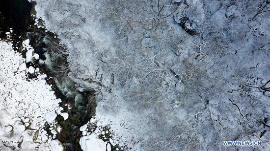 Aerial photo taken on Nov. 25, 2019 shows part of the snow-covered Qinling Mountains in Xi'an, northwest China's Shaanxi Province. (Xinhua/Liu Xiao)