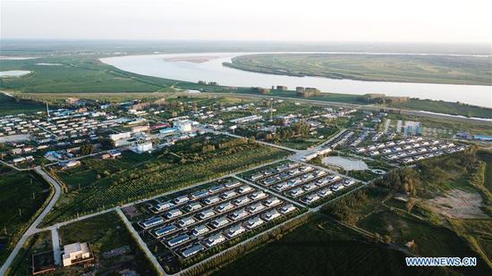 Aerial photo taken on July 21, 2020 shows the Bacha Village in Tongjiang City of northeast China's Heilongjiang Province. Bacha Village, dominated by people of Hezhe ethnic minority, has led a way of poverty relief through developing economy suited to local conditions. All the 14 registered poor families have shaken off poverty. The per-capita disposable income of villagers has been raised to 22,150 yuan (about 3,168 US dollars) in 2019 from 16,102 yuan (about 2,303 US dollars) in 2015. (Xinhua/Wang Jianwei)