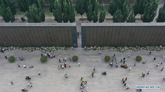 People visit Tangshan Earthquake Ruins Memorial Park in Tangshan, north China's Hebei Province, July 28, 2020, the 44th anniversary of the 1976 Tangshan Earthquake. (Photo by Dong Jun/Xinhua)