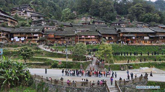 Tourists visit Langde village of Miao ethnic group in Qiandongnan Miao and Dong Autonomous Prefecture of southwest China's Guizhou Province, Oct. 7, 2020. (Photo by Cai Xingwen/Xinhua)