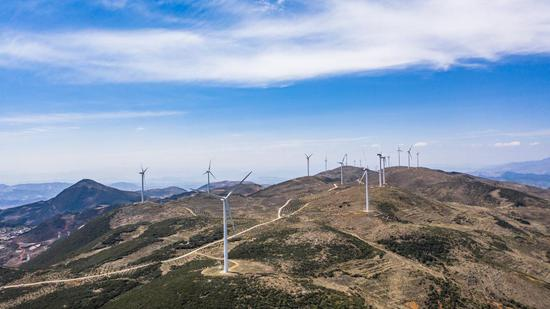 Aerial photo taken on April 26, 2020 shows power-generating windmill turbines in Weining County, southwest China's Guizhou Province. (Xinhua/Tao Liang)
