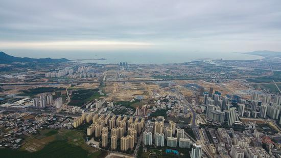 Aerial photo taken on Jan. 5, 2021 shows the Yazhou Bay Science and Technology City under construction in Sanya, south China's Hainan Province. (Xinhua/Yang Guanyu)