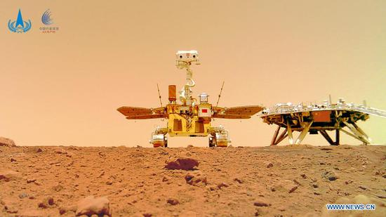 Photo released on June 11, 2021 by the China National Space Administration (CNSA) shows a selfie of China's first Mars rover Zhurong with the landing platform. The China National Space Administration Friday released new images taken by the country's first Mars rover Zhurong, showing national flag on the red planet. The images were unveiled at a ceremony in Beijing, signifying a complete success of China's first mars exploration mission. The images include the landing site panorama, Martian landscape and a selfie of the rover with the landing platform. (CNSA/Handout via Xinhua)