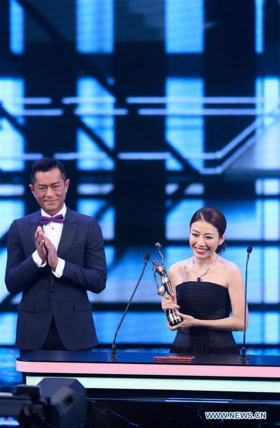 Director Kearen Pang (R) poses during the 37th Hong Kong Film Awards presentation ceremony in Hong Kong, south China, April 15, 2018. Kearen Pang won the Best New Director for film