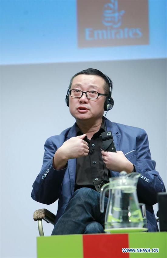 """Chinese sci-fi writer Liu Cixin speaks during a meeting with his readers at the Emirates Airline Festival of Literature in Dubai, the United Arab Emirates (UAE), on March 8, 2019. Liu Cixin, author of Chinese sci-fi bestseller """"The Three-Body Problem,"""" said here in a recent interview with Xinhua that science fiction """"opens our minds to everything that we might see in the future."""" (Xinhua)"""