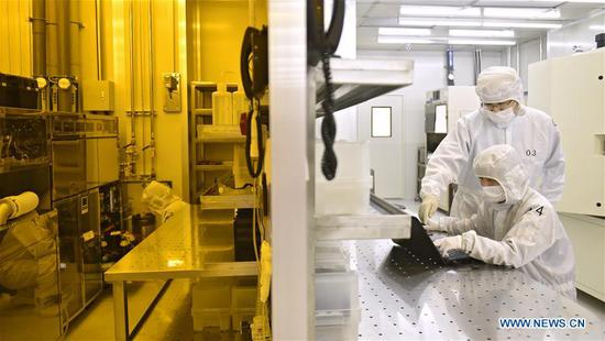Engineers work at Xinguan Technology, a semiconductor high-tech enterprise in Dalian, northeast China's Liaoning Province, April 1, 2019. The 2019 Summer Davos Forum is held from July 1-3 in northeast China's coastal city of Dalian. Established by the World Economic Forum in 2007, the forum is held annually in China, alternating between the two port cities of Dalian and Tianjin. Summer Davos helped Dalian reshape the landscape of regional economy and strengthen the port's trade with other markets. Dalian has become an international city and a showpiece of China's reform and opening up. (Xinhua/Yao Jianfeng)