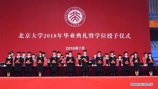 Graduates receive awards at the commencement ceremony of Peking University in Beijing, China, July 10, 2018. A total of 3,313 students graduated from the Peking University and attained the degree of bachelor in 2018. (Xinhua)