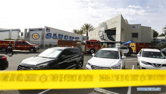 Police cordon off Saugus High School where a shooting took place in Santa Clarita, Southern California, the United States, on Nov. 14, 2019. At least two students were killed and three injured following a shooting Thursday morning at Saugus High School in Santa Clarita, local authorities said. (Xinhua/Li Ying)