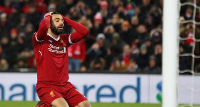Liverpool report striker Salah for driving while using mobile phone