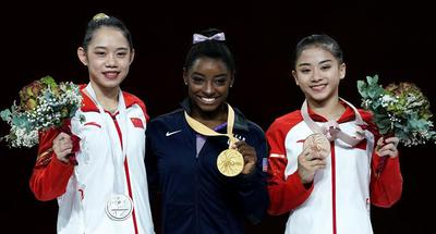 China claims silver and bronze on balance beam at Gymnastics Worlds
