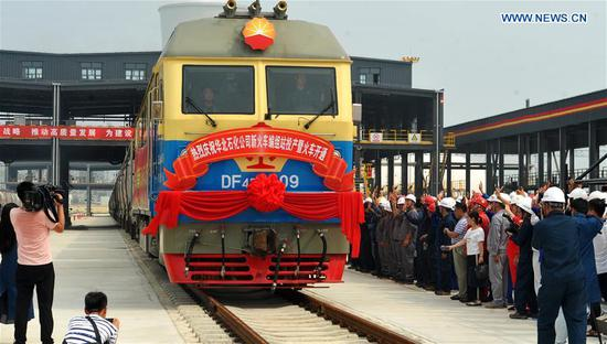The first fully loaded freight train pulls out of the new railway marshalling station of the PetroChina North China Petrochemical Company in Renqiu, Cangzhou, north China's Hebei Province, Aug. 8, 2019. The completion and operation of the new railway marshalling station marks the end of the upgrading and reconstructing program that would expand the company's annual processing capacity to 10 million tonnes. (Xinhua/Zhu Xudong)