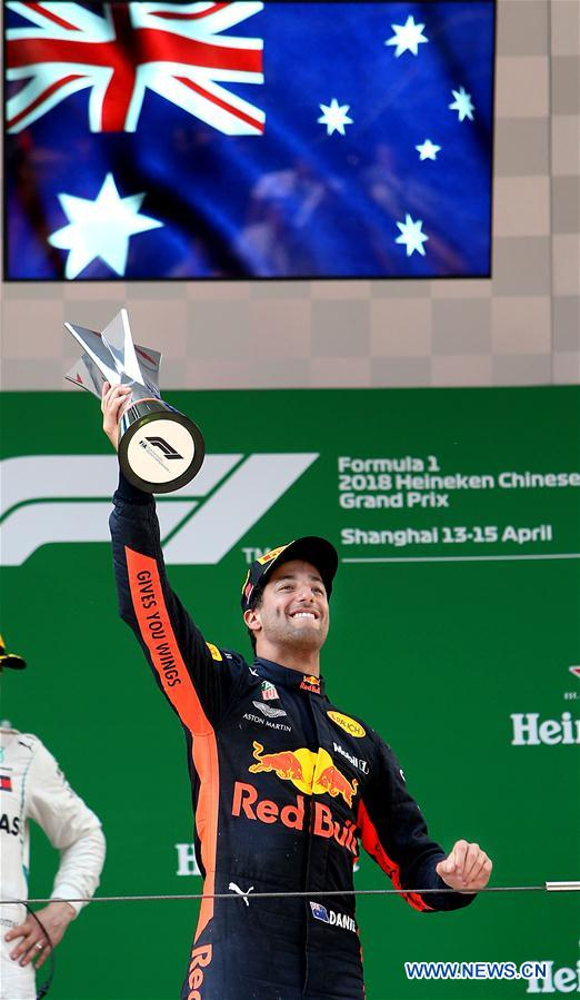 Red Bull's driver Daniel Ricciardo of Australia celebrates with his trophy on the podium after winning the Formula One Chinese Grand Prix in Shanghai, east China, April 15, 2018. Daniel Ricciardo claimed the title of the event in 1 hour, 35 minutes and 36.380 seconds. (Xinhua/Fan Jun)