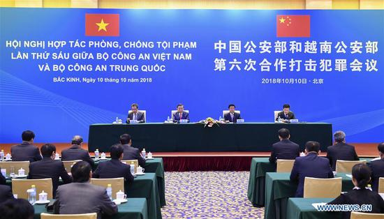 The sixth China-Vietnam public security ministerial meeting on cooperation against crime is held in Beijing, capital of China, Oct. 10, 2018. The meeting was attended by Chinese State Councilor and Minister of Public Security Zhao Kezhi and Vietnamese Minister of Public Security To Lam. (Xinhua/Zhang Ling)