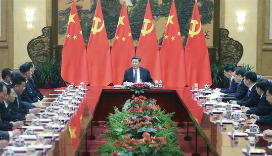 Xi Jinping (C), general secretary of the Central Committee of the Communist Party of China (CPC) and Chinese president, meets with a friendship visiting group of the Workers' Party of Korea (WPK) of the Democratic People's Republic of Korea led by Pak Thae Song, member of the Political Bureau and vice-chairman of the WPK Central Committee, in Beijing, capital of China, May 16, 2018. (Xinhua/Yao Dawei)