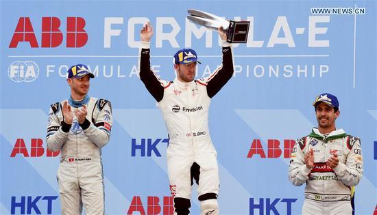 Britain's Sam Bird (C), Switzerland's Edoardo Mortara (L) and Brazil's Lucas Di Grassi pose on the podium during the awarding ceremony after the ABB Formula-E Championship Hong Kong E-Prix in Hong Kong, China, March 10, 2019. (Xinhua/Lo Ping Fai)