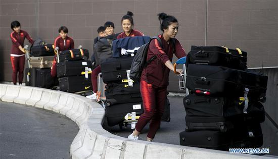 Chinese players wait to get on the bus upon Chinese women's national football team's arrival at the Charles de Gaulle Airport in Paris, France on May 25, 2019. Coaching staff, including head coach Jia Xiuquan, and 26 players landed here early morning on Saturday for final-phase preparation prior to the FIFA Women's World Cup. (Xinhua/Han Yan)