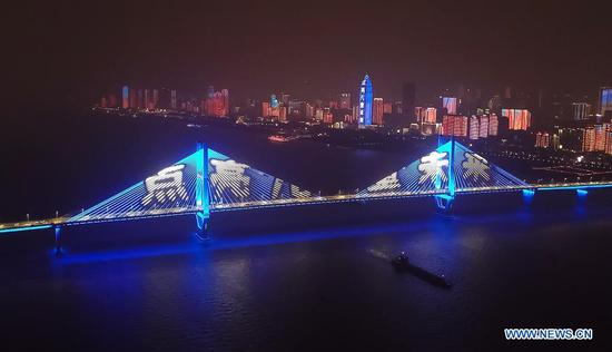 A blue light show is held on the occasion of World Children's Day in Wuhan, central China's Hubei Province, Nov. 20, 2020. Buildings and iconic monuments in some Chinese cities went blue on Friday to celebrate World Children's Day. World Children's Day is celebrated on November 20 each year to promote international togetherness, awareness among children worldwide, and improving children's welfare. (Xinhua/Cheng Min)