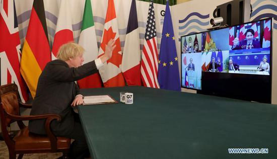 British Prime Minister Boris Johnson speaks during a virtual meeting of the leaders of the Group of Seven at Downing Street in London, Britain, on Feb. 19, 2021. The leaders of the Group of Seven (G7) on Friday pledged to cooperate with the Group of 20 (G20) and other international institutions on a range of global issues including fighting coronavirus pandemic, climate change and upholding the rules-based multilateral trading system, sending signals that the G7 will be committed to multilateral cooperation. (Andrew Parsons/No 10 Downing Street/Handout via Xinhua)