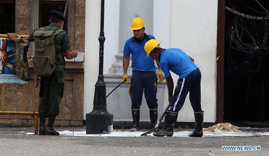 Security forces are seen outside St. Anthony's Church, one of the targets in a series of bomb blasts targeting churches and luxury hotels on Sunday, in Colombo, Sri Lanka, on April 27, 2019. (Xinhua/A. Hapuarachchi)