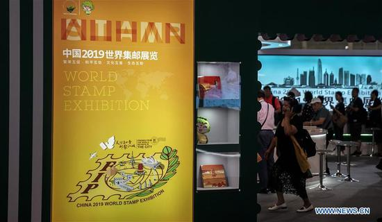 Visitors view stamp exhibits during the 2019 World Stamp Exhibition held in Wuhan, capital of central China's Hubei Province, June 11, 2019. The 2019 World Stamp Exhibition kicked off here on Tuesday. Nearly 4,700 exhibits from more than 80 countries and regions are showcased during the event. (Xinhua/Cheng Min)