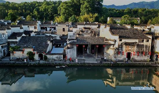 Aerial photo taken by drone shows scenery of Hongcun Village in Yixian County, east China's Anhui Province, May 8, 2018. (Xinhua/Yang Shiyao)