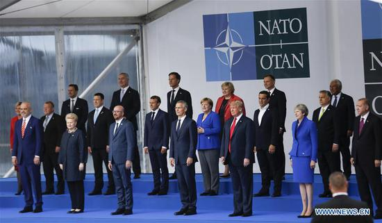 Heads of State and Government pose for a family picture during a NATO summit in Brussels, Belgium, July 11, 2018. NATO leaders gather in Brussels for a two-day meeting. (Xinhua/Ye Pingfan)