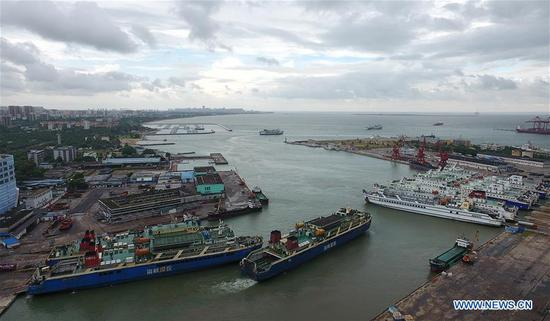 Photo taken on July 2, 2019 shows passenger ferries berthed at the Haikou Harbor in Haikou, south China's Hainan Province. South China's Hainan Province issued an alert for a forthcoming typhoon Tuesday and suspended all ferry services from noon in Qiongzhou Strait. (Xinhua/Guo Cheng)