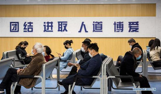 People wait to see doctors at a hospital in Zigui County of Yichang, central China's Hubei Province, March 27, 2020. The normal medical services in Zigui have been gradually resumed as the coronavirus epidemic wanes. (Photo by Wang Jiaman/Xinhua)
