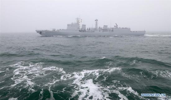The guided-missile destroyer Shijiazhuang of the Chinese People's Liberation Army (PLA) Navy takes part in a naval parade staged to mark the 70th founding anniversary of the PLA Navy on the sea off Qingdao, east China's Shandong Province, on April 23, 2019. (Xinhua/Li Yun)