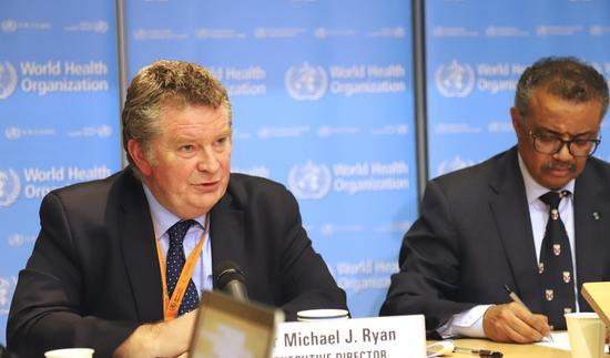 Dr. Michael Ryan(L), executive director of the World Health Organization (WHO) Health Emergencies Program, addresses a press conference in Geneva, Switzerland, Feb. 18, 2020. (Photo by Chen Junxia/Xinhua)