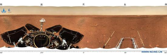 Photo released on June 11, 2021 by the China National Space Administration (CNSA) shows the landing site panorama. The China National Space Administration Friday released new images taken by the country's first Mars rover Zhurong, showing national flag on the red planet. The images were unveiled at a ceremony in Beijing, signifying a complete success of China's first mars exploration mission. The images include the landing site panorama, Martian landscape and a selfie of the rover with the landing platform. (CNSA/Handout via Xinhua)