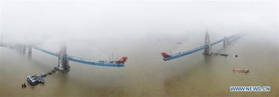 Aerial photo taken on June 27, 2019 shows the construction site of a Yangtze River bridge on the Shanghai-Nantong railway line in Nantong, east China's Jiangsu Province. The south main tower of the bridge was completed on Thursday, marking an important progress of the construction of the cable-stayed railway-expressway bridge. (Xinhua/Xu Congjun)