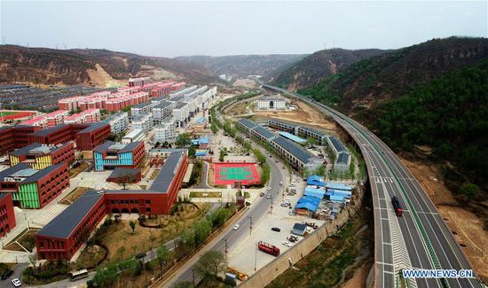 erial photo taken on April 24, 2019 shows the newly-built dwellings and a school in Wen'anyi Town, Yanchuan County of Yan'an City, northwest China's Shaanxi Province. (Xinhua/Liu Xiao)